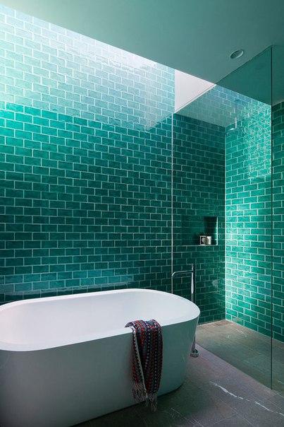 Blue glass subway tile bathroom